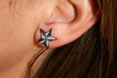 Little_Star_on_the_ear_TaT_by_2Face_Tattoo